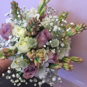brides dusky lilac rose wedding bouquet